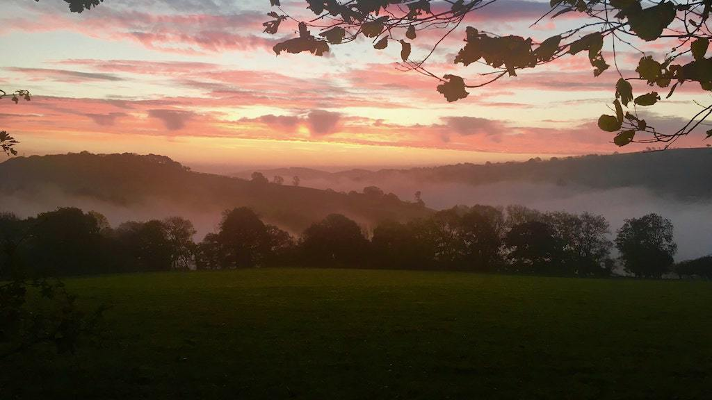 Orange Sunset And Mist In The Valleys As Seen When Glamping In Wales At Strawberry Skys Yurts