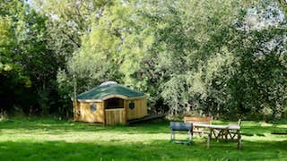 Outside Of Ash Yurt With BBQ And Benches. Glamping Wales At Strawberry Sys Yurts
