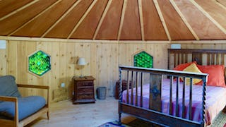 Picture of the bed inside Ash Yurt at strawberry Skys Yurts, Yurts Wales.